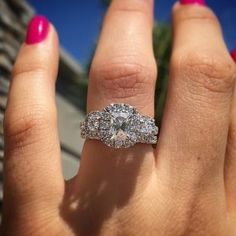 Henri Daussi three stone Halo Engagement Ring