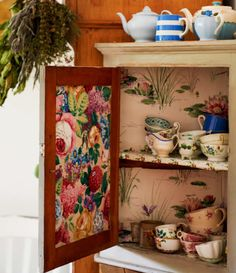 Sarah Moore vintage wallpaper cupboard linings www.apartmentapothecary.com