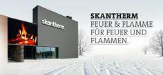 Fabryka nowoczesnych kominków wolnostojących w zimowej scenerii.