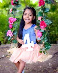 Children photography ideas on wooden swings with flowers. Four 4 year old girl. Find us in laredo at our Facebook page JCPhotography.texas