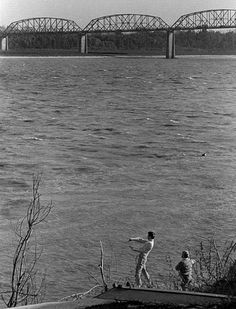 Skipping rocks with the Mississippi River Traffic Bridge in the background 1966