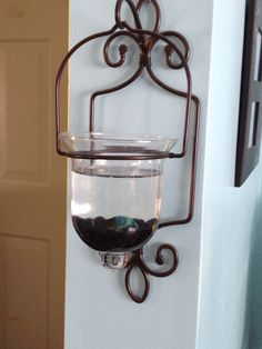 Beta fish in a votive holder. My patients mother is so clever!