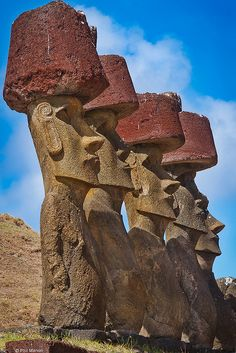 Moai statues on Easter Island, Chile   Scientist Have No Idea How They Got Here-  In 2012, it was discovered that these statues have bodies and feet under the ground which makes it even more of a mystery as they were already too big and heavy for the normal man to move and there were NO methods to do so.