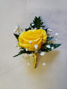 Yellow rose,  baby's breath, and greens with yellow trim. Yellow Boutonniere, Boutonnieres, Baby's Breath, Corsages, Yellow Roses