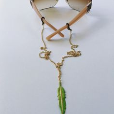 A personal favorite from my Etsy shop https://www.etsy.com/listing/385719208/gold-feather-necklace-for-sunglasses