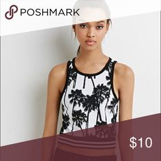 Forever 21 Crop Top Forever 21 black and white palm tree crop top. Good used condition. Mild fading. Pet and smoke free home. Tops Crop Tops