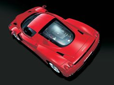 Ferrari Enzo. About as close to an F1 car as you'll ever be able to drive on the street, and with a bigger engine.  It costs eight hundred bucks to change the oil.  (Photo courtesy Ferrari)