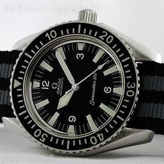 I like this vintage omega seamaster 300 alot. not nearly as expensive as the royal navy watch.