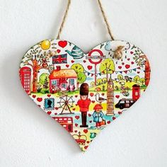 My British Hanging Heart has lots of little illustrations with a British theme. There's London, Big Ben, Queens Guard and much more.More details below. Gifts For Nan, Gifts For Teens, Great Gifts, London Heart, Campervan Gifts, Queens Guard, Shops, Hanging Hearts, Ink Illustrations