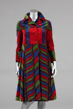 Roberta di Camerino printed velvet coat, late 1960s, the wine ground printed with trompe l'oeil blue straps with green buckles, with patterned skirt and centre-back bodice vent,