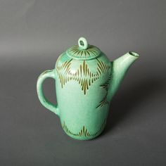 Antique green pottery teapot.