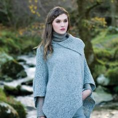 Plated Aran Poncho with Button Detail - Made in Ireland of Soft Merino Wool; direct from the Aran Sweater Market, Aran Islands, Ireland.Famous Original, Since 1892 - ORDER NOW your very own Irish wool poncho cape Wool Cape, Wool Poncho, Crochet Poncho, Poncho Sweater, Knitted Poncho, Tunisian Crochet, Irish Crochet, Celtic Clothing, Irish Clothing