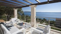 Penelope, Kaminaki & Agni -Sleeps up to 8. Gazing out to sea from a gorgeous pool deck and sunny balconies, this is a cool and contemporary luxury villa in Corfu, positioned directly above a beach and an easy stroll from tavernas.