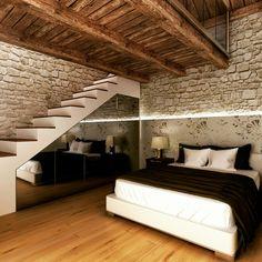 Una camera da letto con soppalco in un appartamento in montagna.