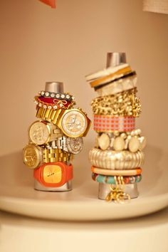 from the girls of lincoln park...Stack your arm parties using paper towel holders or old bottles.