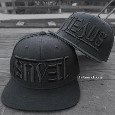 """All black snapback with black 3-D embroidery, classic green under brim. Reads """"SAVED"""" and """"JESUS"""" if you flip it upside down. . . #snapback #headwear #Jesus #saved #christian #style #apparel #styleinspiration #Godfirst"""
