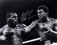 """JSA Witnessed Photo measures 16"""" x 20"""" in size and has been hand-signed in silver paint pen by Mike Tyson. The autograph includes an official James Spence Authentication (JSA) hologram and matching CO"""