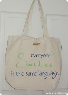 Everyone smiles in the same language - cotton tote bag