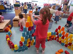 "Building with colourful cups ("",)"