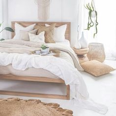 Our Strand Bed in French oak covered in beautiful . Our Strand Bed in French oak covered in beautiful linen Our Mele Stool making the perfect bedside table with our Inkosi Vases available in… Home Interior, Interior Design, Natural Interior, Simple Interior, Natural Home Decor, Bohemian Bedrooms, Bohemian Room, Bright Rooms, Rustic Room