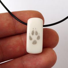 Fox paw, Fox paw pring, Corian jewelry, Scrimshaw, Fox necklace, Fox... (34 AUD) ❤ liked on Polyvore featuring jewelry, necklaces, long necklaces, pendant necklace, fox jewelry, engraved jewelry and fox necklace