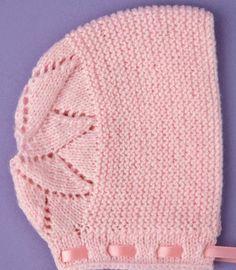 http://kena.com/manualidades/chambrita-tejida-a-mano-con-estambre-color-rosa