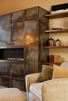 Contemporary Living Room with Acid washed stainless steel fireplace surround, Tory Furniture City Spaces Club Chair Fireplace Tile Surround, Metal Fireplace, Linear Fireplace, Home Fireplace, Modern Fireplace, Fireplace Surrounds, Fireplace Mantels, Fireplace Ideas, Tiled Fireplace Wall