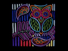 owl stitched on black cotton.  very nice