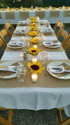Light table, burlap runner/placemats & yellow  flowers (mix in red , white  & blue)