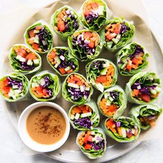 These simple, fresh vegetable spring rolls are great as an appetizer or a light meal. They're paired with an easy creamy peanut sauce. and Drink activities for kids Vegetable Spring Rolls Veggie Recipes, Vegetarian Recipes, Cooking Recipes, Healthy Recipes, Vegetarian Spring Rolls, Healthy Spring Rolls, Clean Eating Snacks, Healthy Snacks, Healthy Eating
