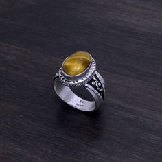 """Sterling Silver & Tigers Eye Ring Stamped """"925 MA-196"""". Manufacturers ID  This is not a stock photo. The image is of the actual article that is being sold  Size: 10  Sterling silver is an alloy of silver containing 92.5% by mass of silver and 7.5% by mass of other metals, usually copper. The sterling silver standard has a minimum millesimal fineness of 925.  All my jewelry is solid sterling silver. I do not plate.   Hand crafted in Taxco, Mexico.  Will ship within 2 days of order. Jewelry…"""