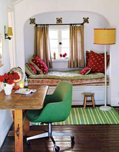 Sometimes quaint is all you need.  This is a cool space...and full of charm from the old desk to the green office chair to the Indian influenced day bed.  I think it is perfect.