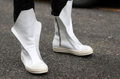 #FuturisticFootwear: These minimalist white high-top sneakers were spotted in #Milan during the second day of #MFW.  WGSN Street Shot, Milan Men's Fashion Week