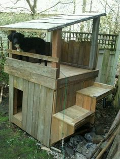 two story dog house  built with the left over scrap wood