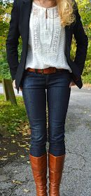 White embroidered blouse, black blazer, jeans, and brown long boot.