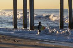 Checking out the surf under the Huntington Beach Pier