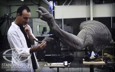 Behind the scenes of JURASSIC PARK. Stan Winston Studio artist Greg Figiel compares the 1/5th scale T-rex arm to the full size version.