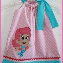 Super cute Bubble Guppies Inspired Molly dress. Made with a pink polka dot and paired with an aqua fabric the dress is a pillowcase style with a side bow and features an applique Bubble Guppie Molly. This dress would be perfect for your little Molly fan or for a Bubble Guppies birthday party theme.  Please leave me a message as to size needed at...