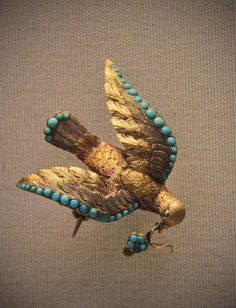 Gold bird brooch with turquoise forget-me-not sprays signifying 'true love', English, mid 19c    @ British Museum