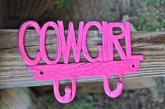 Cowgirl Wall Hook/ Bright Pink/ Country/ Western Theme Distressed Cast Iron Hanger/ Painted/ Girl's Room Decor. $19.99, via Etsy.