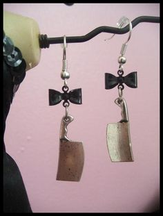 I'm not usually a big fan of bows but theses are too cool!  Miss Cleaver Earrings with Bow by SideshowAccessories on Etsy, $7.50