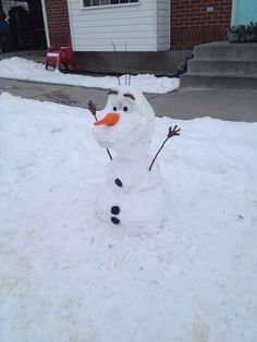 A real-life Olaf, the snowman! All the parts, including the nose, were made out of wood.