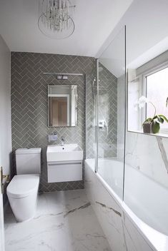 Small bathroom does not have to be boring. One of my favorite bathroom projects! … Small bathroom doesn't need to be boring. One of my favourite bathroom projects! Love the combination of herringbone and marble effect tiles in this bathroom, which togethe Modern Bathroom Design, Bathroom Interior Design, Ideas Baños, Decor Ideas, Decorating Ideas, Tile Ideas, Bathroom Flooring, Bathroom Sinks, Bathroom Remodeling