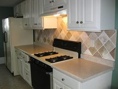 PAINTED backsplash to look like tiles! MUCH cheaper.