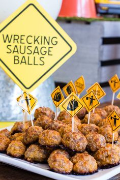 wrecking-sausage-balls Construction themed first birthday party with FREE printables for your own construction party!  construction party | first birthday | smash cake | free printables | free construction party printables | bulldozer party | event decor | party planning | event design | kids party ideas  #constructionparty #freeprintables #firstbirthday #kidspartyideas #eventdesign #eventplanning #smashcake #dumptruck