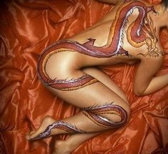Mulan- This breath-taking full-body tattoo is inspired by Disney's Mulan. How amazing! And of course this has some major meaning behind it, like all Disney movies. Mushu is a sort of guardian of Mulan although he is far from perfect. He shows strength and vulnerability at the same time which ultimately helps Mulan.