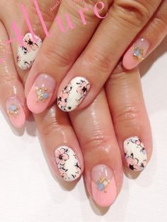 Pink nail tips with decols on nude background, pared with white nails with pink flowers.