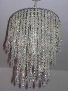 clear beaded chandelier lamp shade going to make a slightly less blingy version of this to go over sophies light beaded lighting