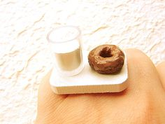 Donut and glass of milk...on a ring. Actually, everything in their store is cute (though I know I'd catch the rings on something and break them!).  SouZou Creations @ Etsy.