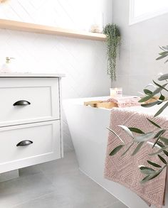 I absolutely love our feature wall with this crisp white herringbone tile. It really brightens up the bathroom too!